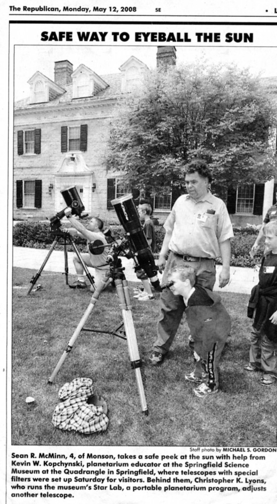 Kevin with his telescope and museum patrons